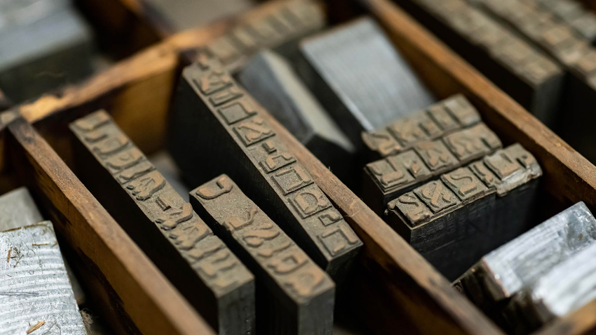 Closeup of printing type in a wooden printer's tray