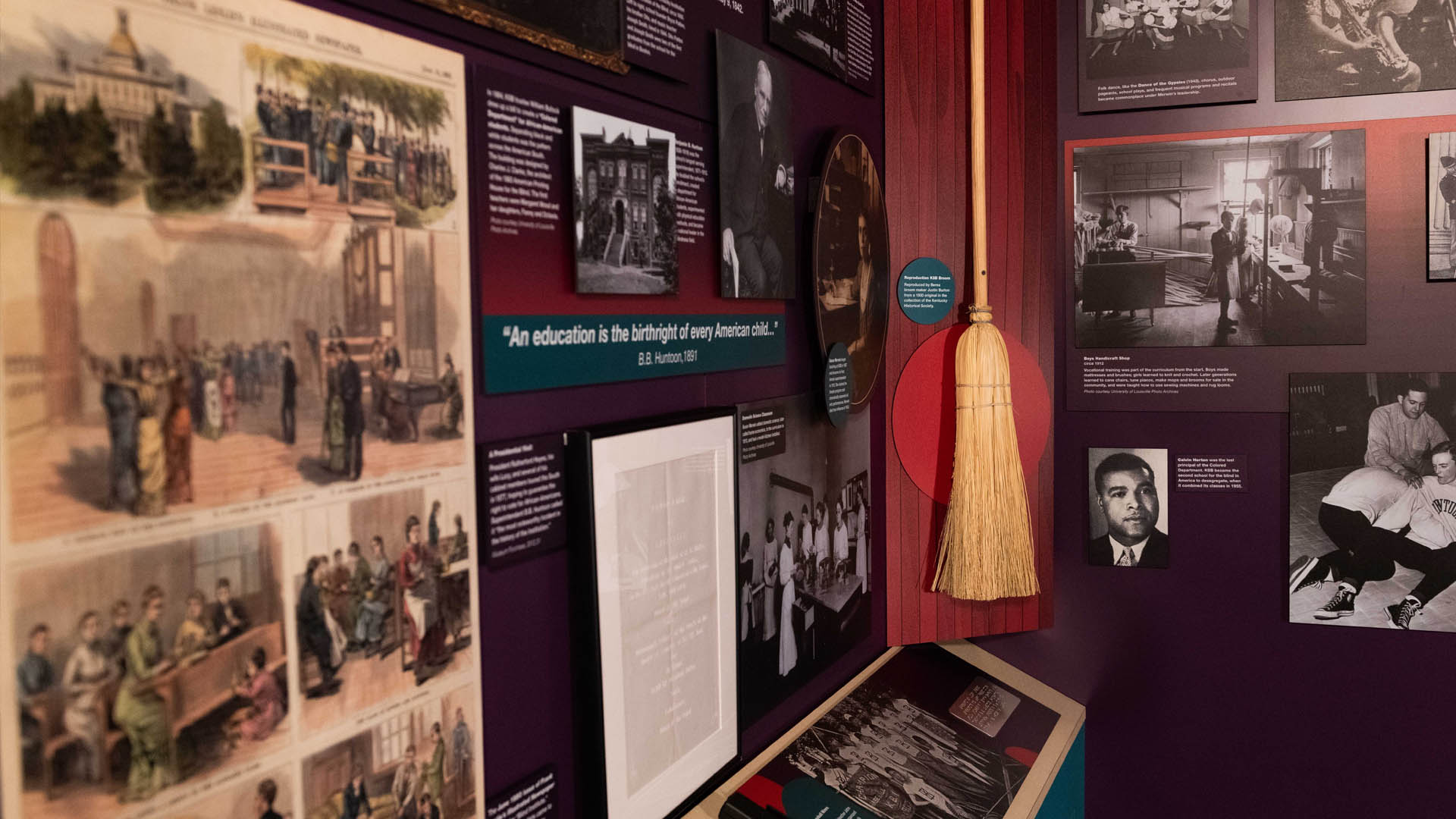 Exhibit display with pictures from the Kentucky School for the Blind and a traditional broom