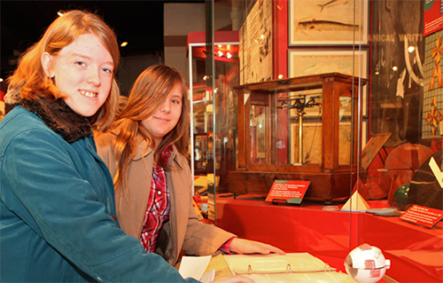 two girls at APH Museum exhibit